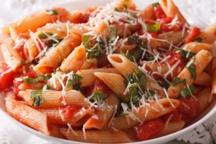 Arrabiata pasta penne with Parmesan cheese macro. horizontal